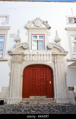 Streets in Alfama district in Lisbon in summer - Stock Photo