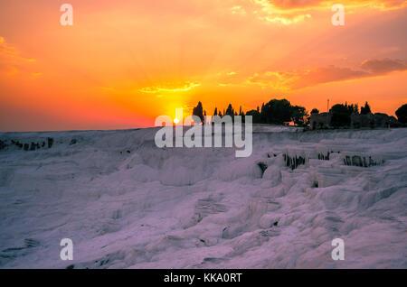 Pink sunset over Pamukkale, Turkey - Stock Photo