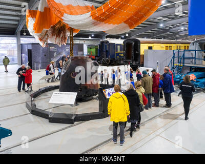 Crowd of people and children viewing Soyuz Descent Module TMA-19M which brought  Astronaut Major Tim Peake down - Stock Photo