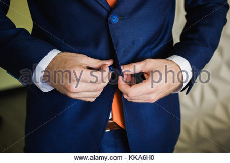 Man buttoning his jacket. Men's style. Professions. Preparing to work on meeting. - Stock Photo
