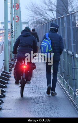 Cologne, Germany. 29th Nov, 2017. Cyclists and pedestrians have to share a small pavement on the Zoo bridge crossing - Stock Photo
