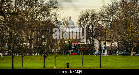 Peckham, London, UK. 30th Nov, 2017. The dome of St Paul's Cathedral viewed through the trees from Peckham Rye Park - Stock Photo