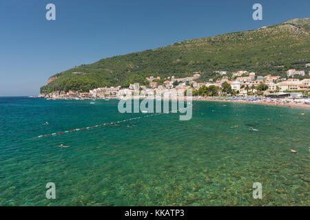 People swimming in Adriatic Sea, resort town of Petrovac, Montenegro, Europe - Stock Photo