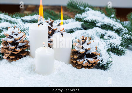 Christmas and New Year background with Christmas candle and Christmas tree branches on snow and decorations. Free - Stock Photo