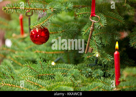 Christmas Tree with Decoration and Old Rusty Key - Stock Photo