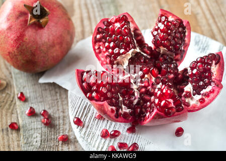 Pomegranate on the wooden board - Stock Photo