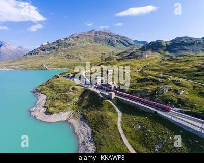 Bernina Express - Red train on Bernina Pass - Stock Photo