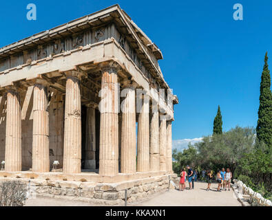 Tourists in front of the Temple of Hephaestus (Hephaistos) in the precinct of the Ancient Agora, Athens, Greece - Stock Photo