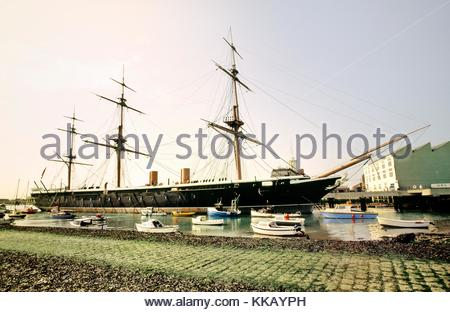 HMS Warrior at Portsmouth Historic Dockyard, Hampshire, England. Launched 1860. Britains first iron hulled armoured - Stock Photo