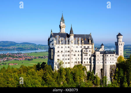 Neuschwanstein Castle, in the back Forggensee, Schwangau, Königswinkel, Ostallgäu, Allgäu, Swabia, Bavaria, Germany - Stock Photo