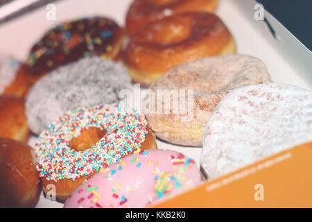 Tasty donuts being tasty. - Stock Photo