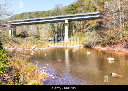 Williams river in autumn with stones, bridge and Highland Scenic highway road in West Virginia Monongahela National - Stock Photo