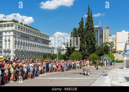 Tourists watching the changing of the guard at the Tomb of the Unknown Soldier, Syntagma Square, Athens, Greece - Stock Photo