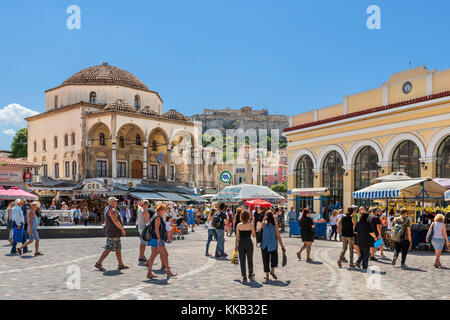 Shops and flea market stalls in Monastiraki Square (Platia Monastirakiou) with the Acropolis in the distance, Monastiraki, - Stock Photo