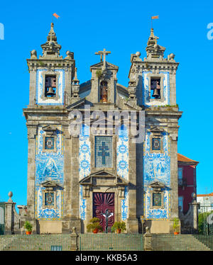 View of famous Church of Santo Ildefonso that was built in 17th century. Porto, Portugal - Stock Photo