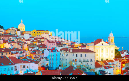 Skyline of Lisbon Old Town at dusk. Portugal - Stock Photo