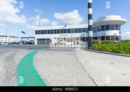 AUCKLAND, NEW ZEALAND - NOVEMBER 27, 2017; Green line sign on footpath showing way between international and domestic - Stock Photo