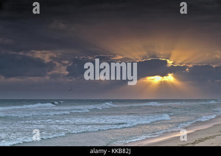 Sunset in Ilha Deserta (Desert Island) in Faro, Algarve, Portugal - Stock Photo