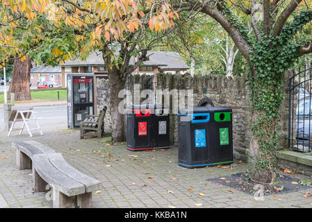 Recycling bins on a pavement in Builth Wells, Powys, Wales, UK. - Stock Photo