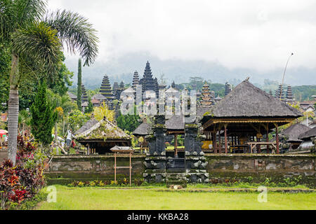 Pura Besakih, largest and holiest temple of Hindu religion in Bali on the slopes of Mount Agung, volcano in eastern - Stock Photo