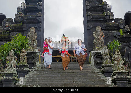 Indonesian tourists visiting Pura Besakih, largest and holiest temple of Hindu religion in Bali on the slopes of - Stock Photo