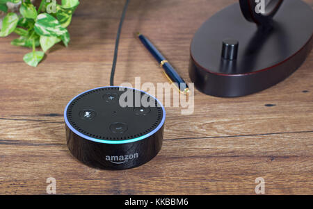 Amazon echo dot, a hands free voice controlled device that connects to the Alexa voice service - Stock Photo