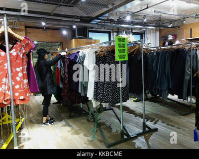 a shopper in an Urban Outfitters retail store in Herald Square in New York on Sunday, November 26, 2017 during the - Stock Photo