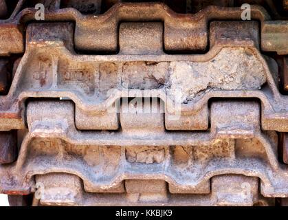 Abstract image of tank tracks. Tank tread tires. Steel textured tire tracks. Military transportation. Military vehicle - Stock Photo