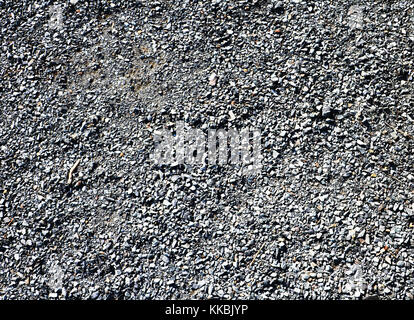 Granite gravel of macadam, rock gray crushed for construction on the ground, scree texture background. - Stock Photo