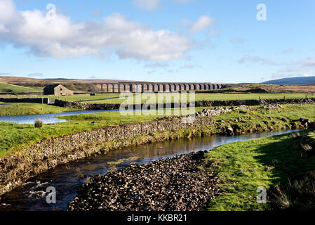 A minerals freight train crosses Ribblehead viaduct, Near Ingleton, North Yorkshire, in the Yorkshire Dales National - Stock Photo