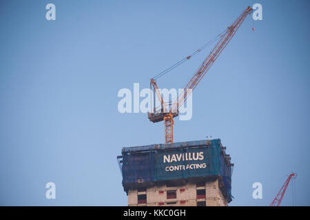 A banner for Navillus Contracting atop Brookfield's Manhattan West development in New York on Sunday, November 26, - Stock Photo