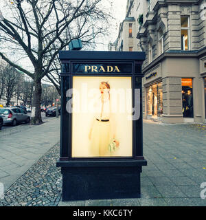 Glass display cabinet for luxury boutique Prada on famous shopping street Kurfurstendamm , Kudamm, in Berlin, Germany. - Stock Photo