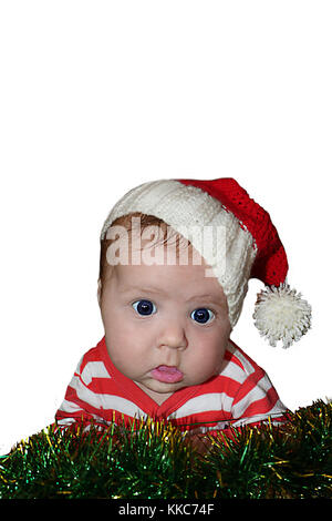 Cute Santa baby with dumbfounded face dressed in red sanata hat and stripped red jacket  isolated on white background. - Stock Photo