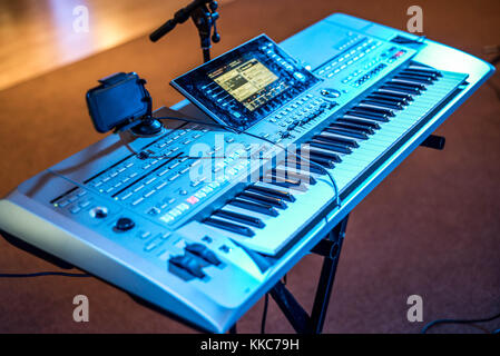 Classical electronical music keyboard view in blue concert lights bokeh background musician - Stock Photo