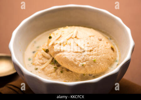 Ras malai or Rasmalai or rossomalai is Indian dessert food made using Jaggery or gur and sugar. It is a rich cheesecake - Stock Photo