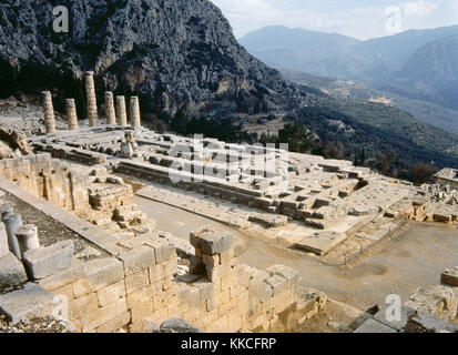 Greece. Delphi. Ancient sanctuarly. Ruins of  the ancient Temple of Apollo, 4th century BC. Doric style. Valley - Stock Photo