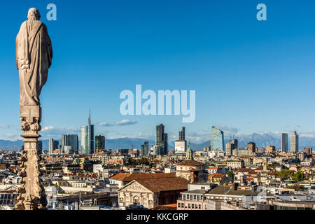 City skyline with the Alps in the background, Milan, Lombardy, Italy - Stock Photo