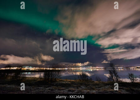Aurora Borealis or northern lights over winter landscape of Tromso, Troms, Norway, Europe - Stock Photo
