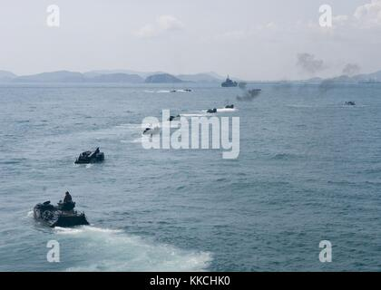 Marines assigned to 4th Marine Regiment drive their amphibious assault vehicles from the amphibious dock landing - Stock Photo