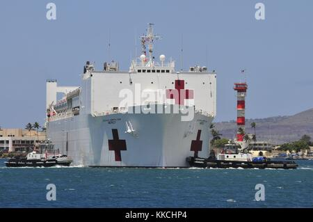 The Military Sealift Command hospital ship UNSN Mercy T-AH-19 pulls into Joint Base Pearl Harbor-Hickam during Pacific - Stock Photo