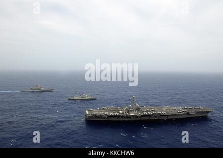 The Nimitz-class aircraft carrier USS George Washington CVN 73 is alongside the Royal Australian Anzac-class guided - Stock Photo