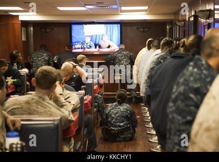 Sailors and Marines play bingo in the Carlson Cafe aboard the multi-purpose amphibious assault ship USS Makin Island - Stock Photo