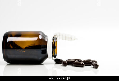 Multivitamins capsule pills for pregnant woman with amber bottle with blank label and copy space isolated on white - Stock Photo
