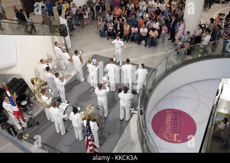Members of the US 7th Fleet Far East Edition Band entertain Thai nationals during a show at the Terminal 21 Mall - Stock Photo
