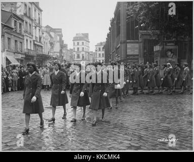 Members of the 6888th Central Postal Directory Battalion take part in a parade ceremony in honor of Joan d'Arc at - Stock Photo