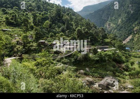 Suspension bridge on the Manaslu Circuit Trek, Nepal - Stock Photo