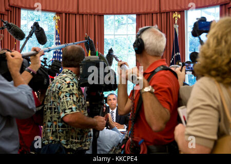 Members of the press document President Barack Obama during the Honoring America's Veterans and Caring for Camp - Stock Photo