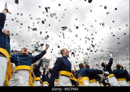 Newly commissioned second lieutenants throw their hats in the air during the commencement ceremony at the United - Stock Photo