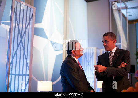 President Barack Obama talks with President Asif Ali Zardari of Pakistan before a meeting on Afghanistan with heads - Stock Photo