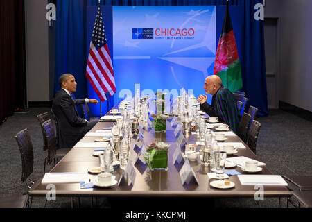 President Barack Obama talks with President Hamid Karzai of Afghanistan during the NATO Summit in Chicago, Ill., - Stock Photo